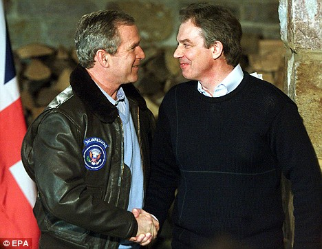 Former US President George W. Bush ex-PM Tony Blair shake hands at Camp David before the invasion of Iraq