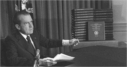 President Nixon pointing to the transcripts of White House tapes in April 1974, after he announced that he would give the material to lawmakers and make them public.