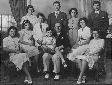 A Kennedy family portrait taken in Bronxville, NY. Seated (left to right): Eunice, Jean, Edward, Joseph Sr., Patricia, and Kathleen. Standing: Rosemary, Robert, John, Rose, and Joseph Jr.